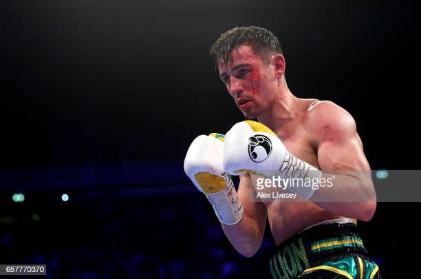 An injured Anthony Crolla of Great Britain looks on as he fights Jorge Linares of Venezuela during the WBC Diamand and Ring Magazine Lightweight...