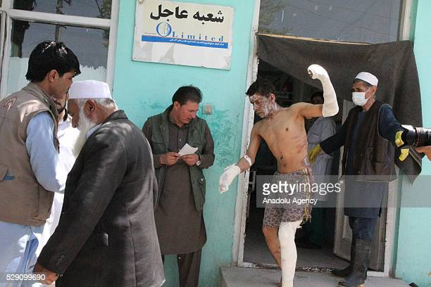 An injured boy is seen outside a hospital after two buses and a fuel tanker collided on a major highway in the Ghazni province of Afghanistan on May...
