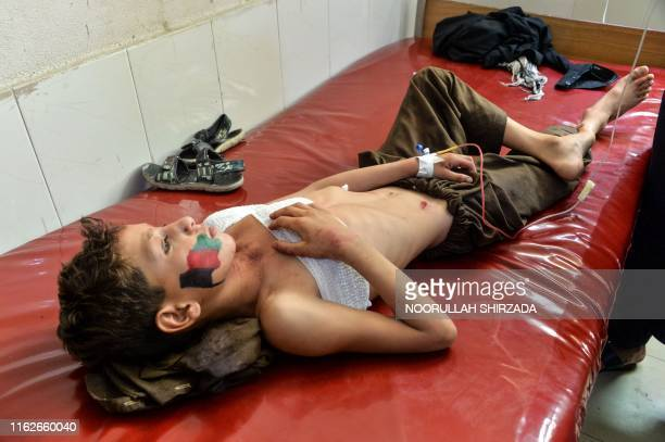 An injured boy receives medical treatment a hospital, following multiples of bomb blasts in Jalalabad on August 19, 2019. - Afghanistan's...