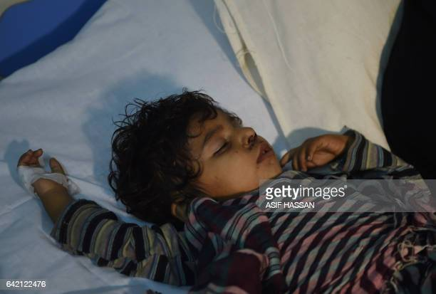 An injured child is treated at a local hospital in the town of Sehwan a day after a bomb attack hit the 13th century Muslim Sufi shrine of Lal...