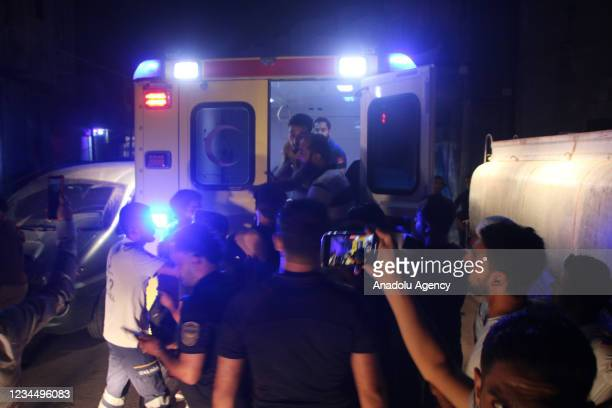 An injured citizen is being taken to the hospital as White Helmets conduct an operation the site after PKK , and YPG, launched a missile attack in...