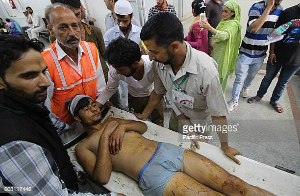 An injured civilian is being shifted to a hospital in Srinagar the summer capital of Indian controlled Kashmir Hundreds of civilians sustained...