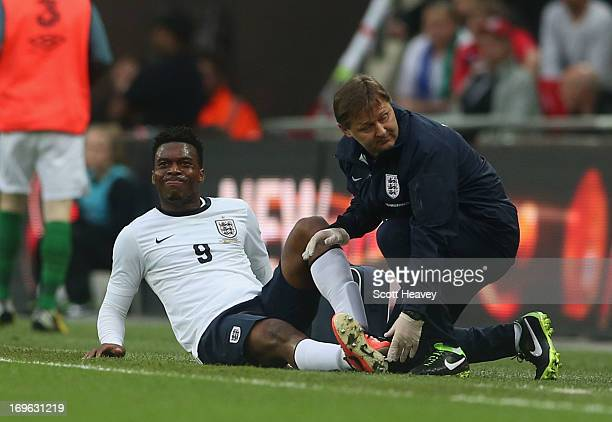 An injured Daniel Sturridge of England is given treatment by physio Gary Lewin during the International Friendly match between England and the...