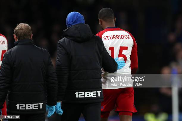 An injured Daniel Sturridge of West Bromwich Albion leaves the pitch during the Premier League match between Chelsea and West Bromwich Albion at...
