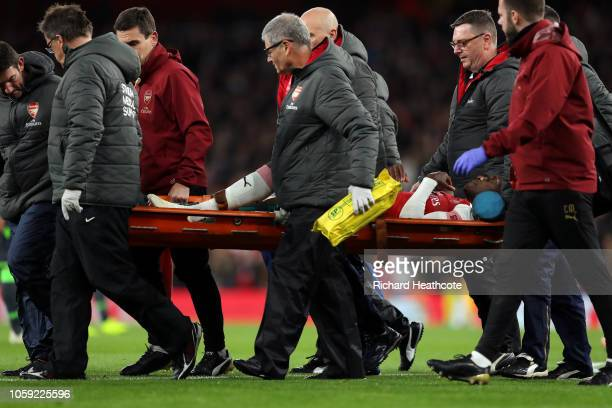 An injured Danny Welbeck of Arsenal is carried off on a stretcher during the UEFA Europa League Group E match between Arsenal and Sporting CP at...