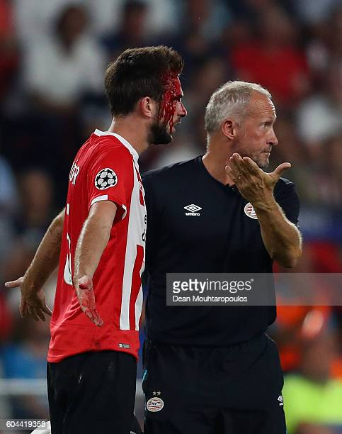 An injured Davy Propper of PSV Eindhoven reacts during the UEFA Champions League Group D match between PSV Eindhoven and Club Atletico de Madrid at...