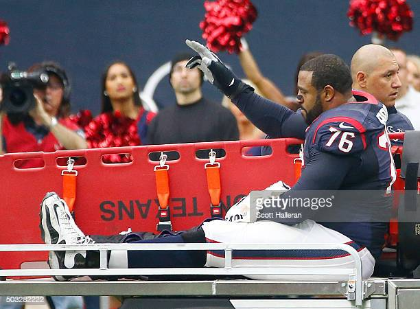 An injured Duane Brown of the Houston Texans is carted off the field while playing agains the Jacksonville Jaguars in the first quarter on January 3,...