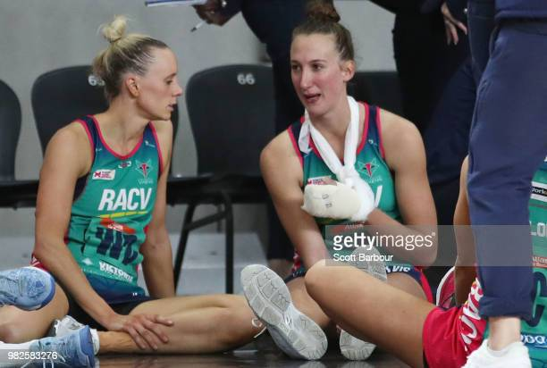 An injured Emily Mannix of the Vixens speaks with Renae Ingles after the round eight Super Netball match between Magpies and the Vixens at Margaret...