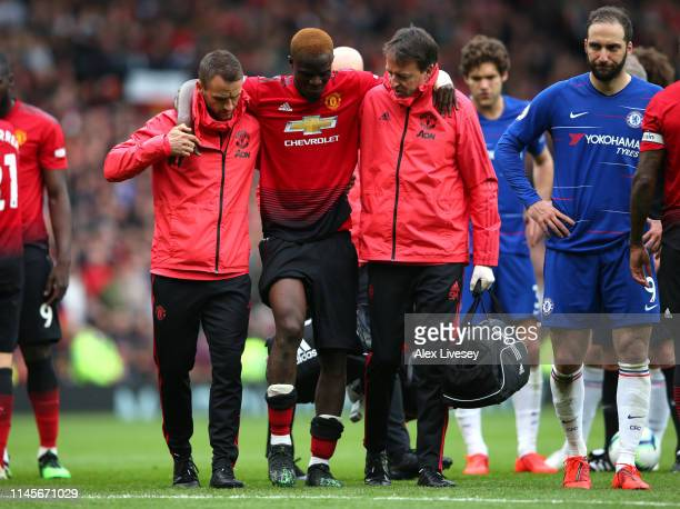 An injured Eric Bailly of Manchester United is given assistance during the Premier League match between Manchester United and Chelsea FC at Old...