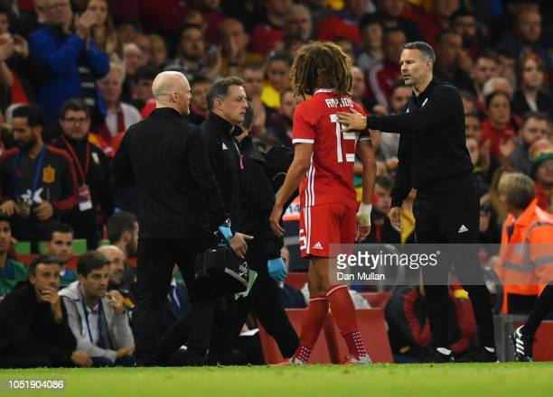 An injured Ethan Ampadu of Wales is consoled by Ryan Giggs Manager of Wales during the International Friendly match between Wales and Spain on...