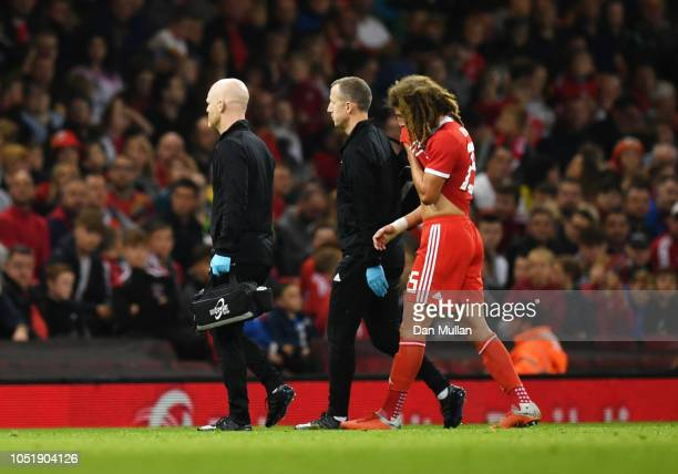 An injured Ethan Ampadu of Wales leaves the pitch during the International Friendly match between Wales and Spain on October 11 2018 in Cardiff...