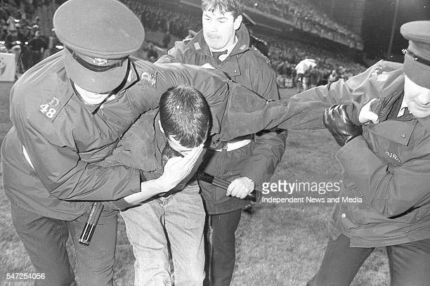 An injured fan following the riot at the Ireland v England at Landsdowne Road in Dublin. Following the Irish goal a riot erupted and the game was...