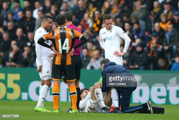 An injured Fernando Llorente of Swansea City is given treatment during the Premier League match between Hull City and Swansea City at KCOM Stadium on...