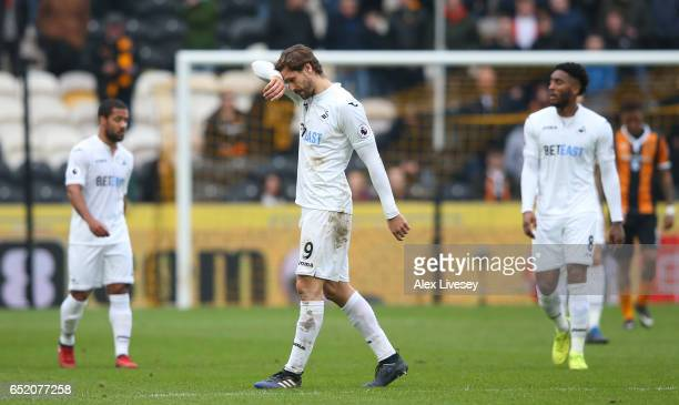 An injured Fernando Llorente of Swansea City reacts as he is substituted during the Premier League match between Hull City and Swansea City at KCOM...