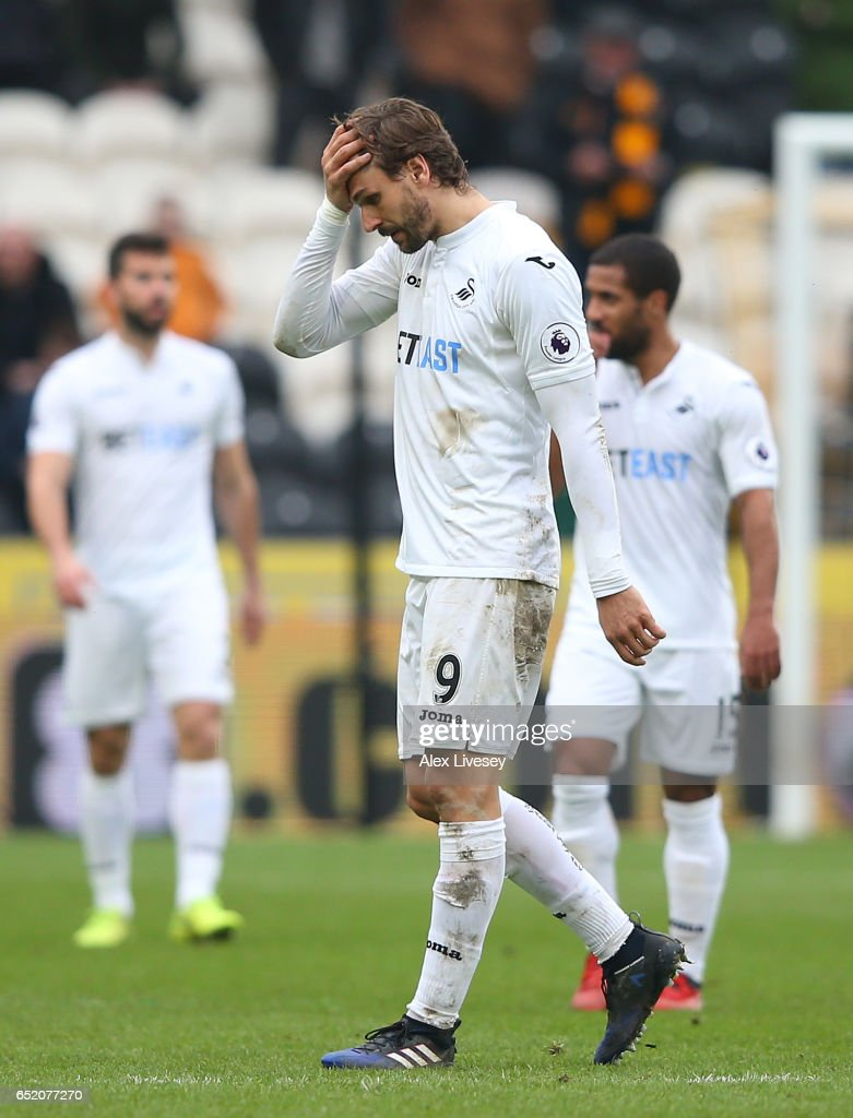 An injured Fernando Llorente of Swansea City reacts as he is substituted during the Premier League match between Hull City and Swansea City at KCOM Stadium on March 11, 2017 in Hull, England.