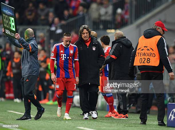 An injured Franck Ribery of Bayern Muenchen walks with club doctor HansWilhelm MuellerWohlfahrt as he is substituted during the UEFA Champions League...