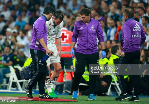 An injured Gareth Bale of Real Madrid leaves the pitch during the La Liga match between Real Madrid CF and FC Barcelona at Estadio Bernabeu on April...