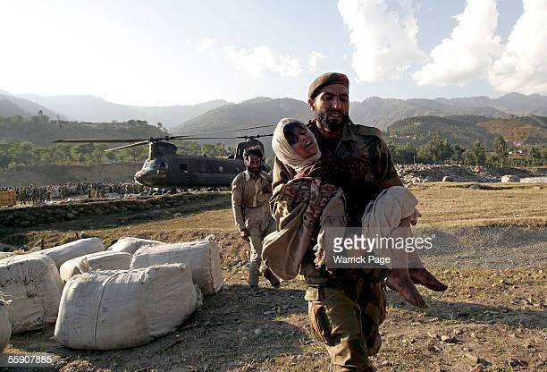 An injured girl is carried to a US Army helicopter for evacuation October 12 2005 in Balakot Pakistan Over 30000 people are believed to have died in...