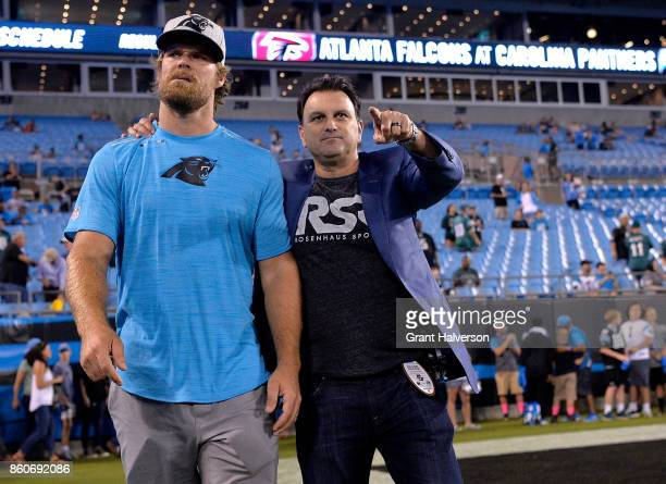 An injured Greg Olsen of the Carolina Panthers walks with his agent, Drew Rosenhaus, before their game against the Philadelphia Eagles at Bank of...