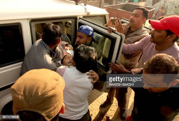 An injured Indian civilian is taken to a hospital following shelling across the IndiaPakistan border in Kapoorpur village about 35km from Jammu on...