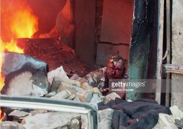 An injured Iraqi man asks for help at the the scene of a car bomb on June 14 2004 in Baghdad Iraq A car bomb exploded at rush hour as three civilian...