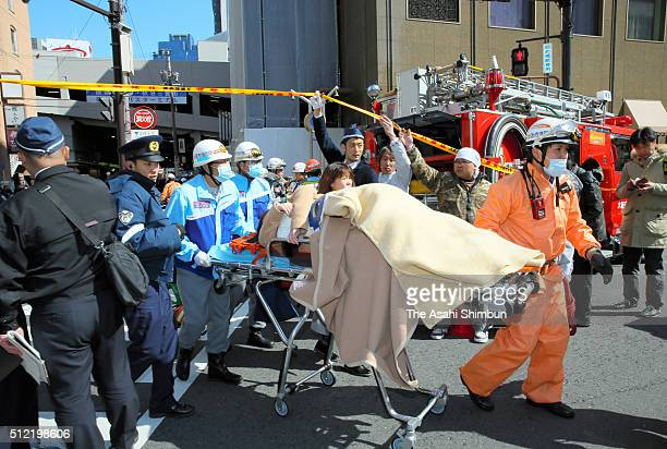 An injured is carried by a stretcher after a car crashed into pedestrians at Umeda area on February 25 2016 in Osaka Japan Two people including the...