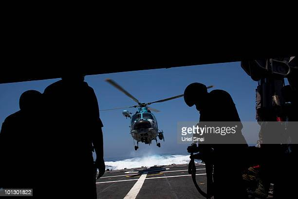 An injured Israeli Navy special forces soldier leaves aboard a helicopter as the Israeli Navy Intercepts peace boats bound for Gaza on May 31 2010 in...