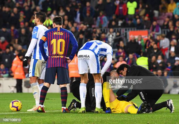 An injured Ivan Cuellar of Leganes is given treatment during the La Liga match between FC Barcelona and CD Leganes at Camp Nou on January 20 2019 in...