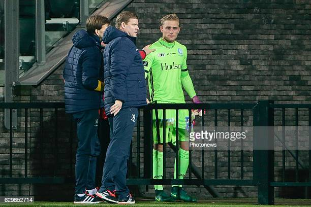 An injured Jacob Rinne goalkeeper of KAA Gent with Hein Vanhaezebrouck Headcoach of KAA Gent during the Croky Cup quarter final match between KV...