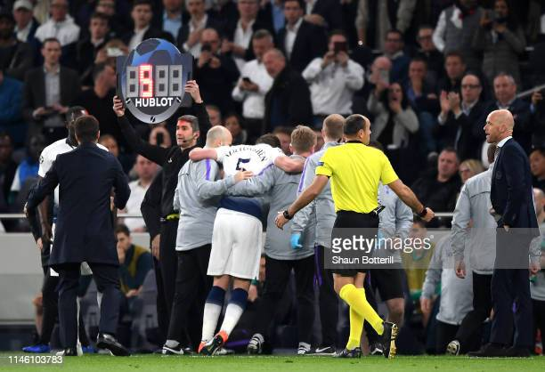 An injured Jan Vertonghen of Tottenham Hotspur is given assistance as he is substituted during the UEFA Champions League Semi Final first leg match...