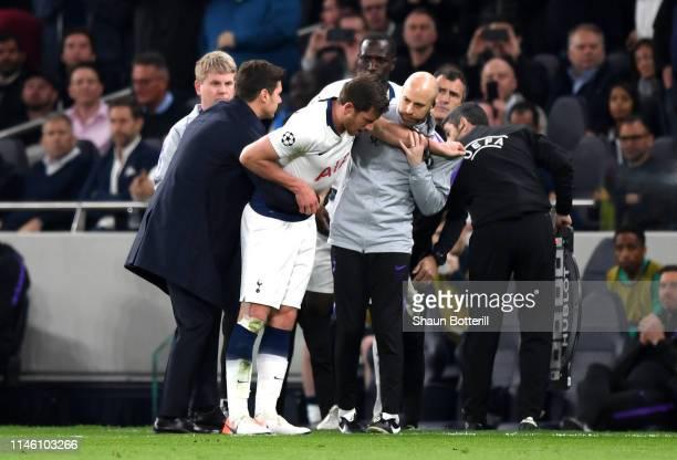 An injured Jan Vertonghen of Tottenham Hotspur is given assistance during the UEFA Champions League Semi Final first leg match between Tottenham...