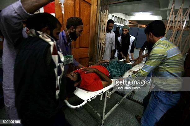 An injured Kashmiri man is brought for treatment to a hospital on September 11 2016 in Srinagar India 78 civilians have been killed and more than...