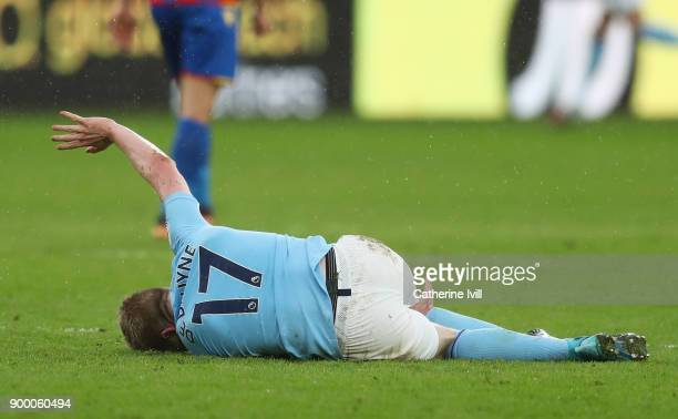 An injured Kevin De Bruyne of Manchester City reacts during the Premier League match between Crystal Palace and Manchester City at Selhurst Park on...