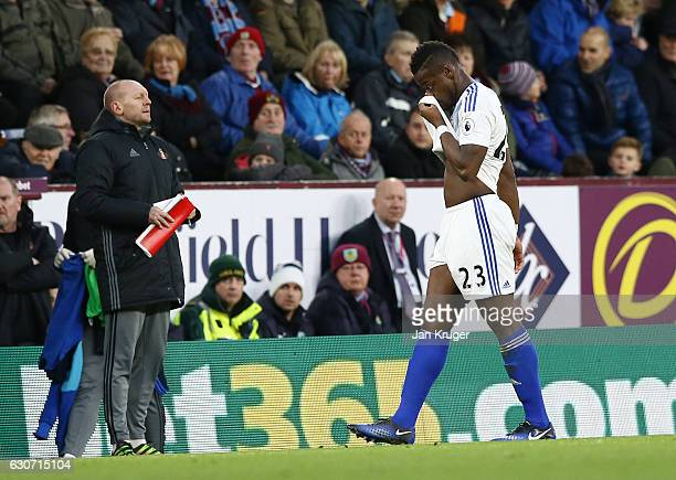 An injured Lamine Kone of Sunderland is substituted during the Premier League match between Burnley and Sunderland at Turf Moor on December 31 2016...