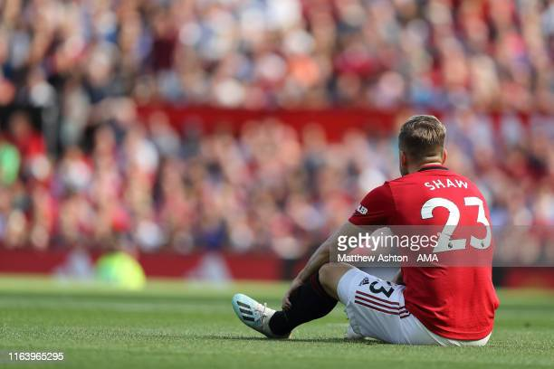 An injured Luke Shaw of Manchester United during the Premier League match between Manchester United and Crystal Palace at Old Trafford on August 24,...