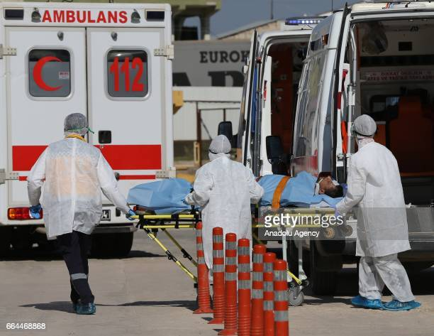 An injured man is being brought to Reyhanli State Hospital in Hatay Turkey on April 4 2017 Assad regime's suspected chlorine gas attack took place in...