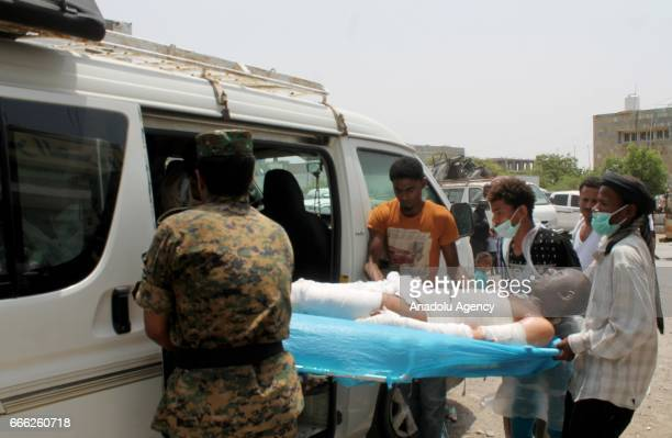 An injured man is being taken to a nearest hospital in Al Hudaydah Yemen on April 8 2017 Yesterday unidentified attackers started a fire at a...