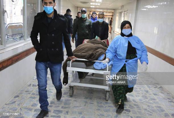 An injured man is rushed to the emergency ward of a hospital following a twin suicide bombing on a bustling commercial street in the heart of the...