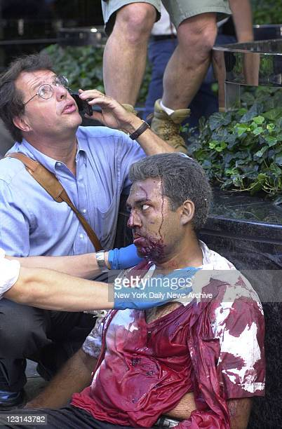 An injured man is tended to after a terrorist attack on the World Trade Center A hijacked American Airlines Boeing 767 originating from Boston's...