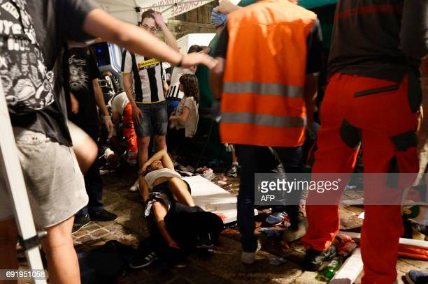 An injured man lies on the ground at Piazza San Carlo after a panic movement in the fanzone where thousands of Juventus fans were watching the UEFA...