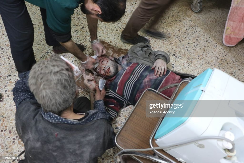 An injured man receives medical treatment at a field hospital as Assad Regime forces carried out airstrikes over Arbin town of the Eastern Ghouta region, which is a de-escalation zone of Damascus in Syria on February 20, 2018.