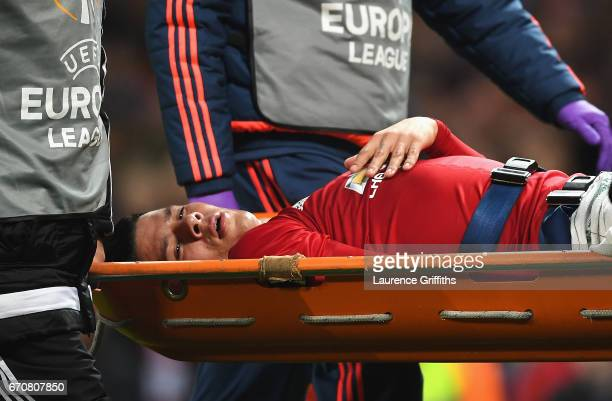 An injured Marcos Rojo of Manchester United is stretchered off during the UEFA Europa League quarter final second leg match between Manchester United...