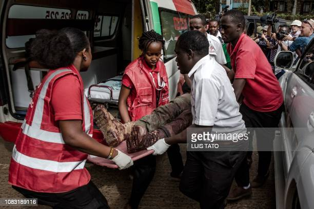 TOPSHOT An injured member of the Kenyan security forces is evacuated from the scene of the terrorist attack at the hotel complex in Nairobi's...