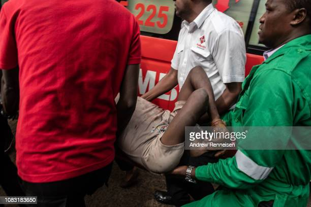 An injured member of the Kenyan security forces is removed from the Dusit Hotel on January 16 2018 in Nairobi Kenya A security operation has...