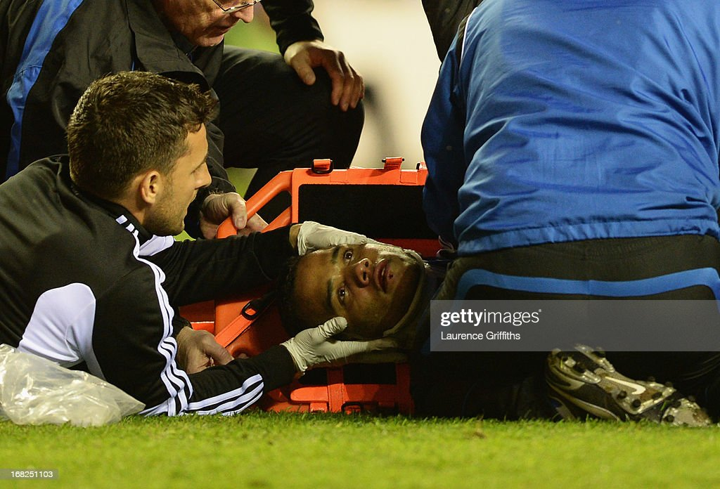 An injured Michel Vorm of Swansea City is given treatment during the Barclays Premier League match between Wigan Athletic and Swansea City at DW Stadium on May 7, 2013 in Wigan, England.