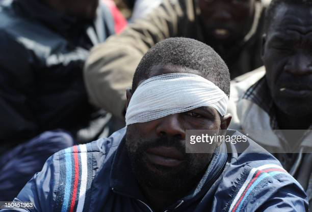 An injured miner listens to Former African National Congress' Youth League leader on August 18 2012 at Londonlisted Lonmin's Marikana platinum mine...