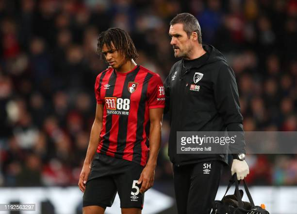 An injured Nathan Ake of AFC Bournemouth is substituted during the Premier League match between AFC Bournemouth and Liverpool FC at Vitality Stadium...