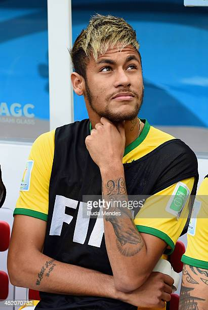 An injured Neymar of Brazil looks on from the bench during the 2014 FIFA World Cup Brazil Third Place Playoff match between Brazil and the...