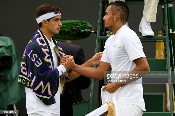 An injured Nick Kyrgios of Australia shakes hands with PierreHugues Herbert of France as he retires during the Gentlemen's Singles first round match...