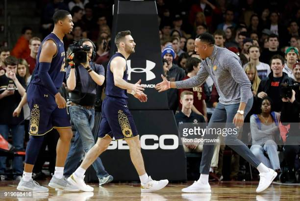 An injured Notre Dame Fighting Irish forward Bonzie Colson rushes out to congratulate Notre Dame Fighting Irish guard Matt Farrell after one of his...